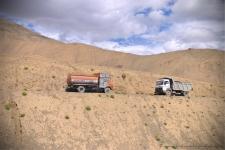 Trucks head to head on the narrow detour we took to reach Lamayuru