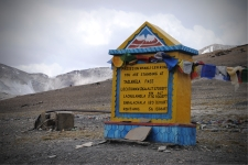 Signboard at Tanglang La indicating distance to other high altitude passes in the region